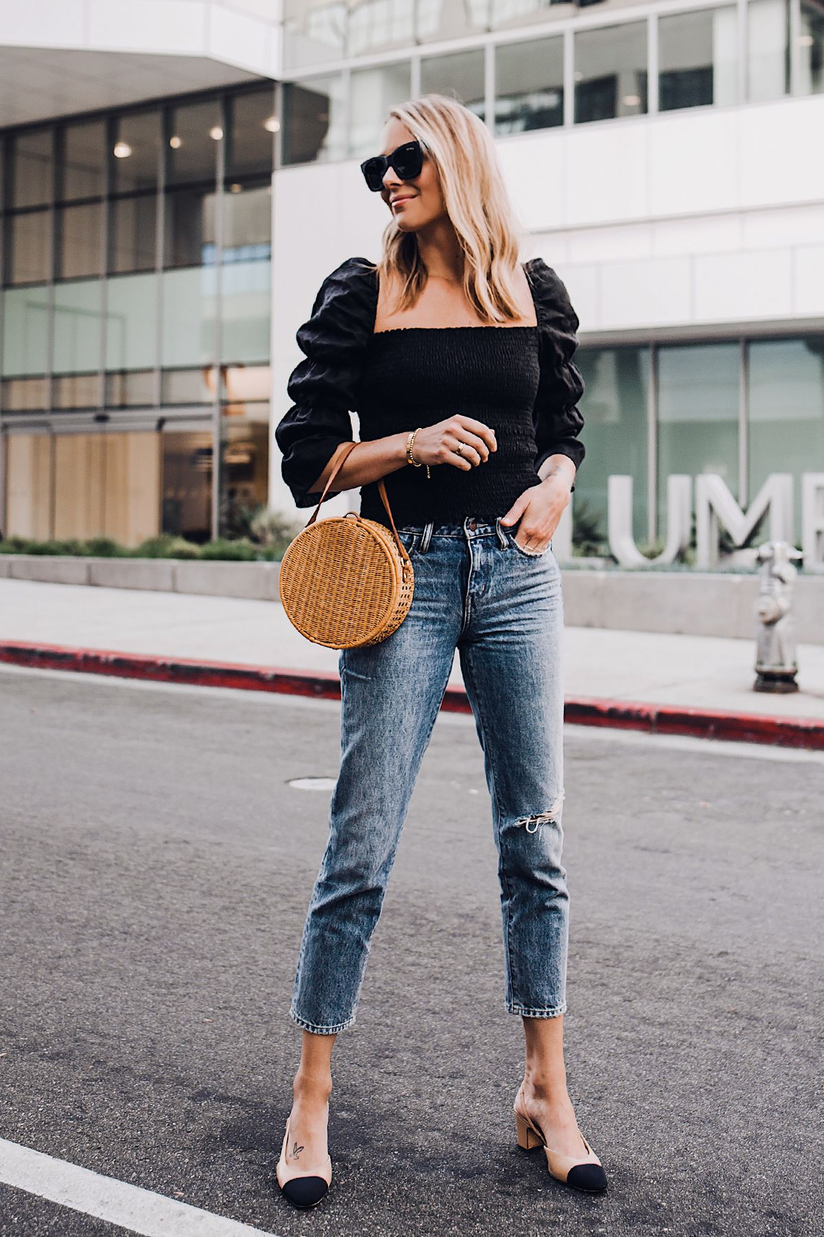 938b50f2afc3 Blonde Woman Wearing Fashion Jackson Reformation Gala Top Black Straight  Leg Ripped Jeans Chanel Slingback Shoes Cane Circle Straw Handbag Black  Sunglasses ...
