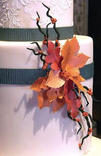 A corsage of frosting leaves and branches for an elegant lace cake.