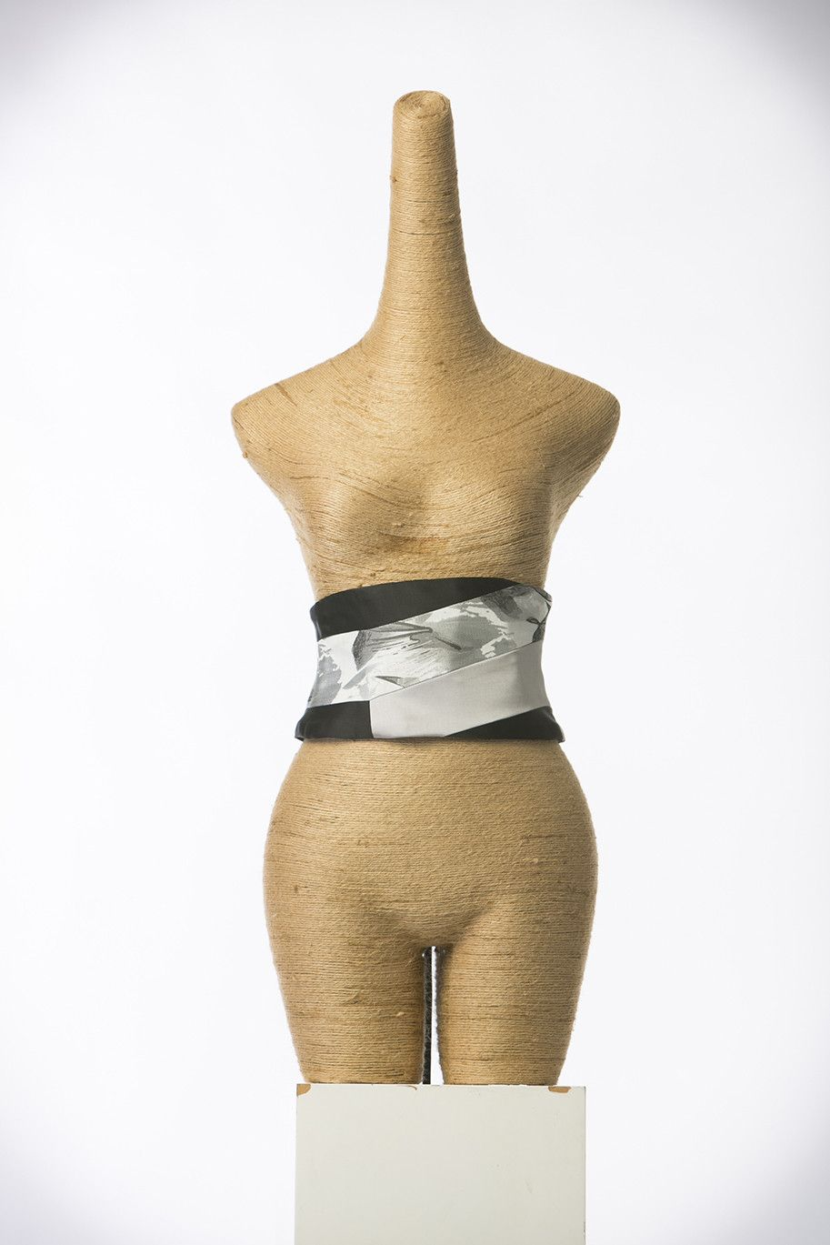 One of a kind, completely reversible cumber belt that is made up of Vintage Kimono silk sourced from Japan; hand stitched to perfection. May it be to dress up t
