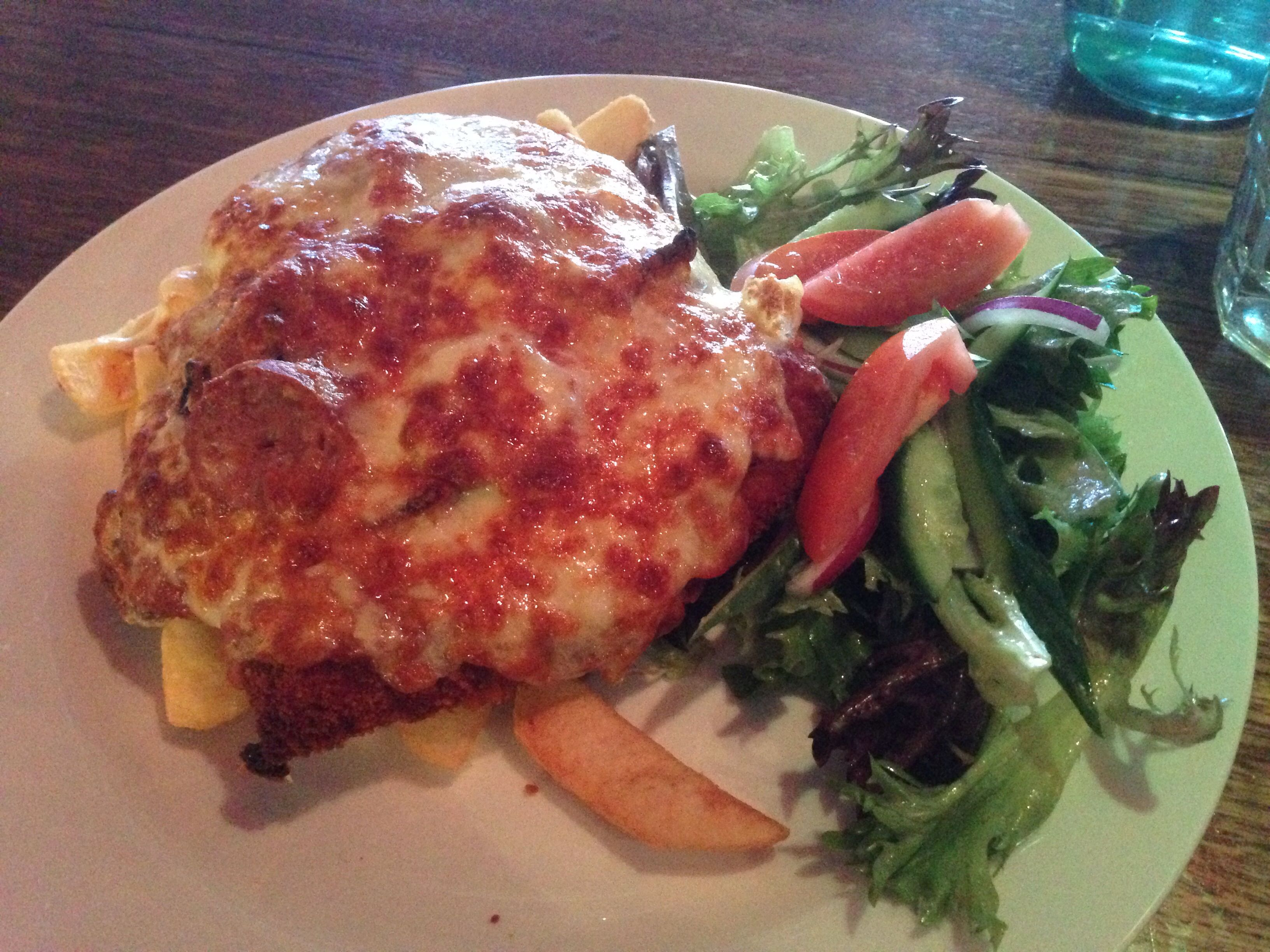 Snag Parma - Chicken Parma plus bacon and sausage, accompanied with chips and salad all for $13!