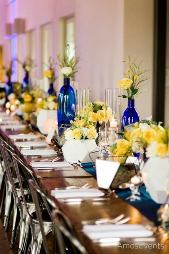 Long wedding reception table we created from a design by Amos Gott. A collected look with varied elements unified by the floral in yellows and green. #AmosEvents #NashvilleWeddings