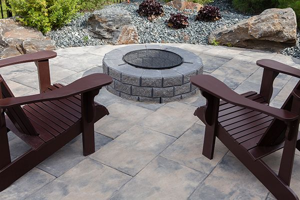Have a seat and enjoy relaxing in front of your Stone Oasis Circle Firepit