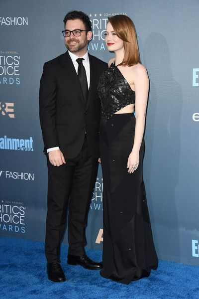 Emma Stone Photos Photos - Spencer Stone (L) and actress Emma Stone attend The 22nd Annual Critics' Choice Awards at Barker Hangar on December 11, 2016 in Santa Monica, California. - The 22nd Annual Critics' Choice Awards - Arrivals