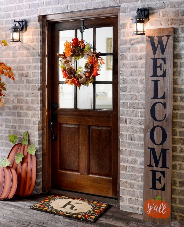 welcome guests with fall door decorations