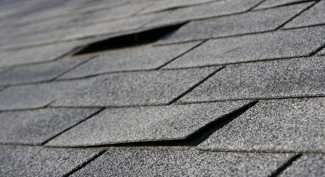 Strong Winds From Storms Cause Shingles To Lift And Crease