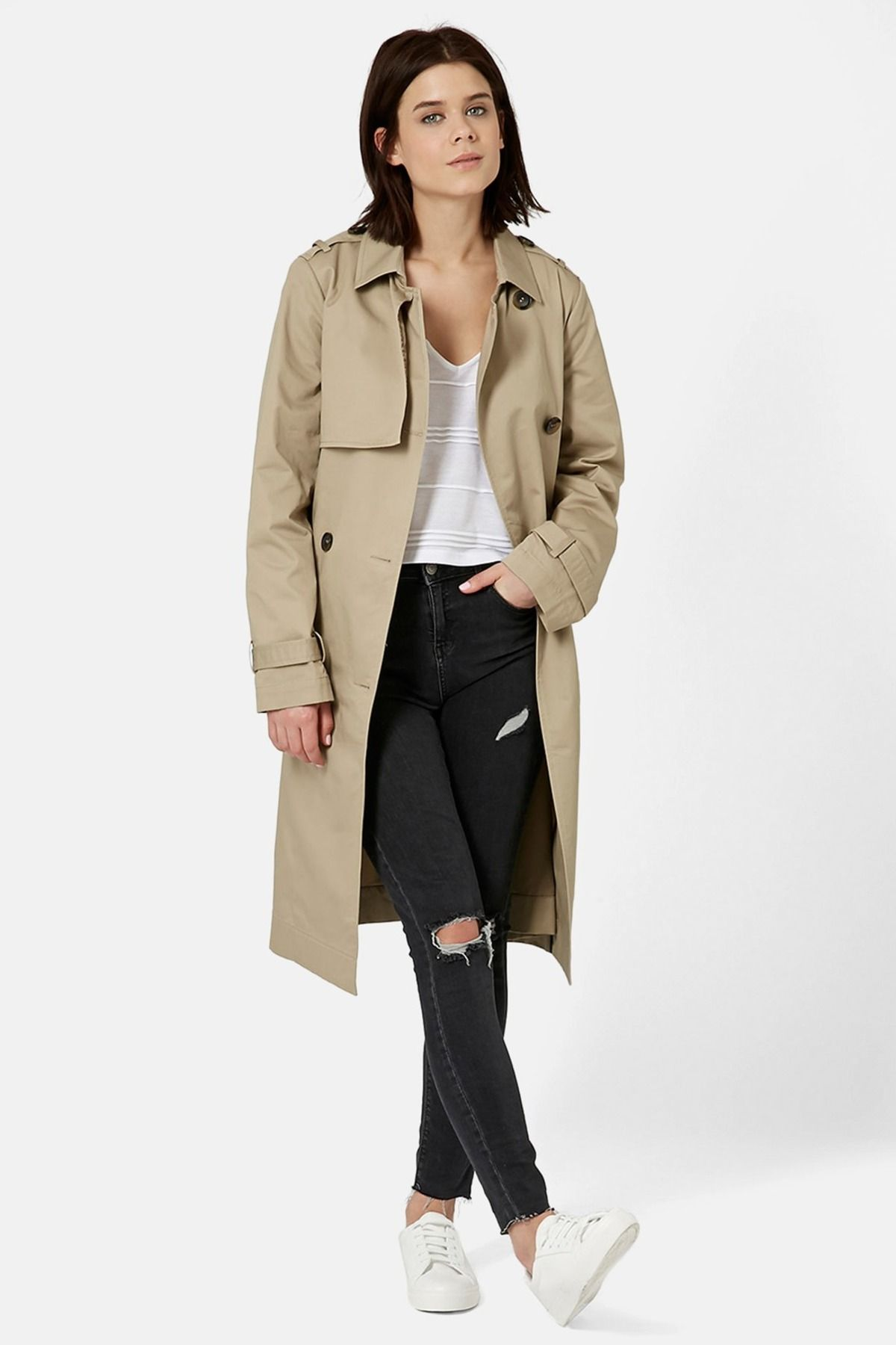 This classic tan trench has all the features, from the double-breasted front and belted waistline to a gunflap and a storm flap.