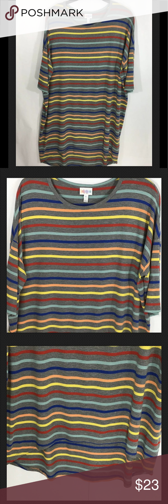 LuLaRoe Irma Multicolored Striped High/Low Dress Multicolored stripe high/low dress with short sleeves. Measurements are approximate and taken laying flat from seam to seam  Width: 25' under arm seam to seam  Length: 31' front  Length: 35' back #0137 LuLaRoe Dresses High Low