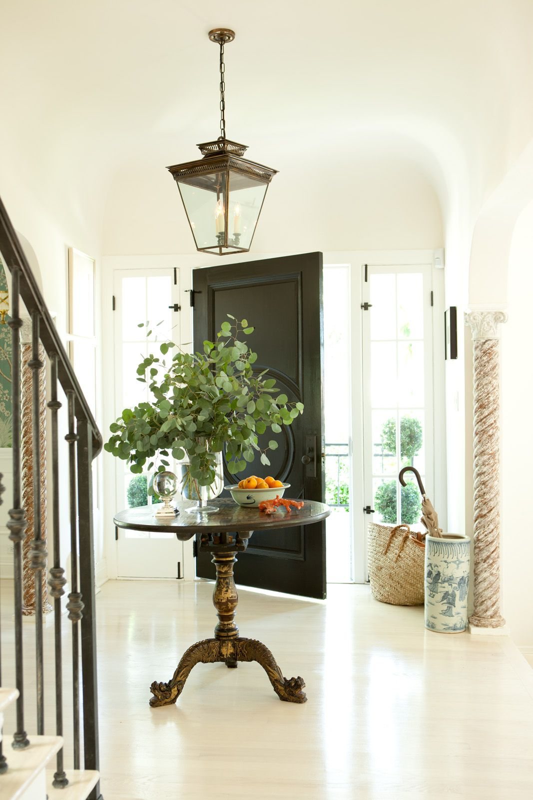 Hollywood Hills No 1 Mark D Sikes Large Bright Foyer With Lantern Pedestal Table And Striking Black Door Round Entry Table Home Decor Home