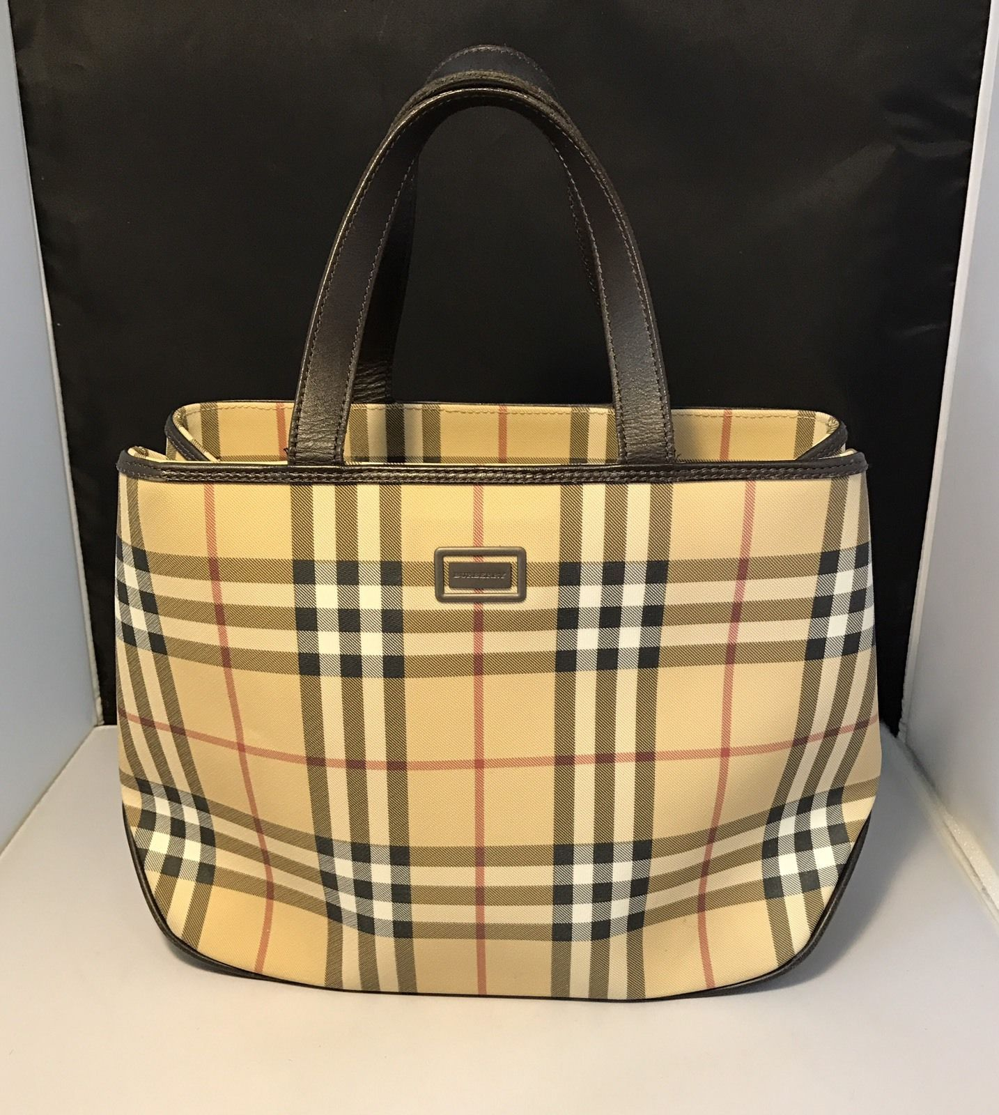 ba7f70c2711a Explore these ideas and much more! Authentic Burberry Nova Check Coated  Canvas Leather Medium Tote Bag ...