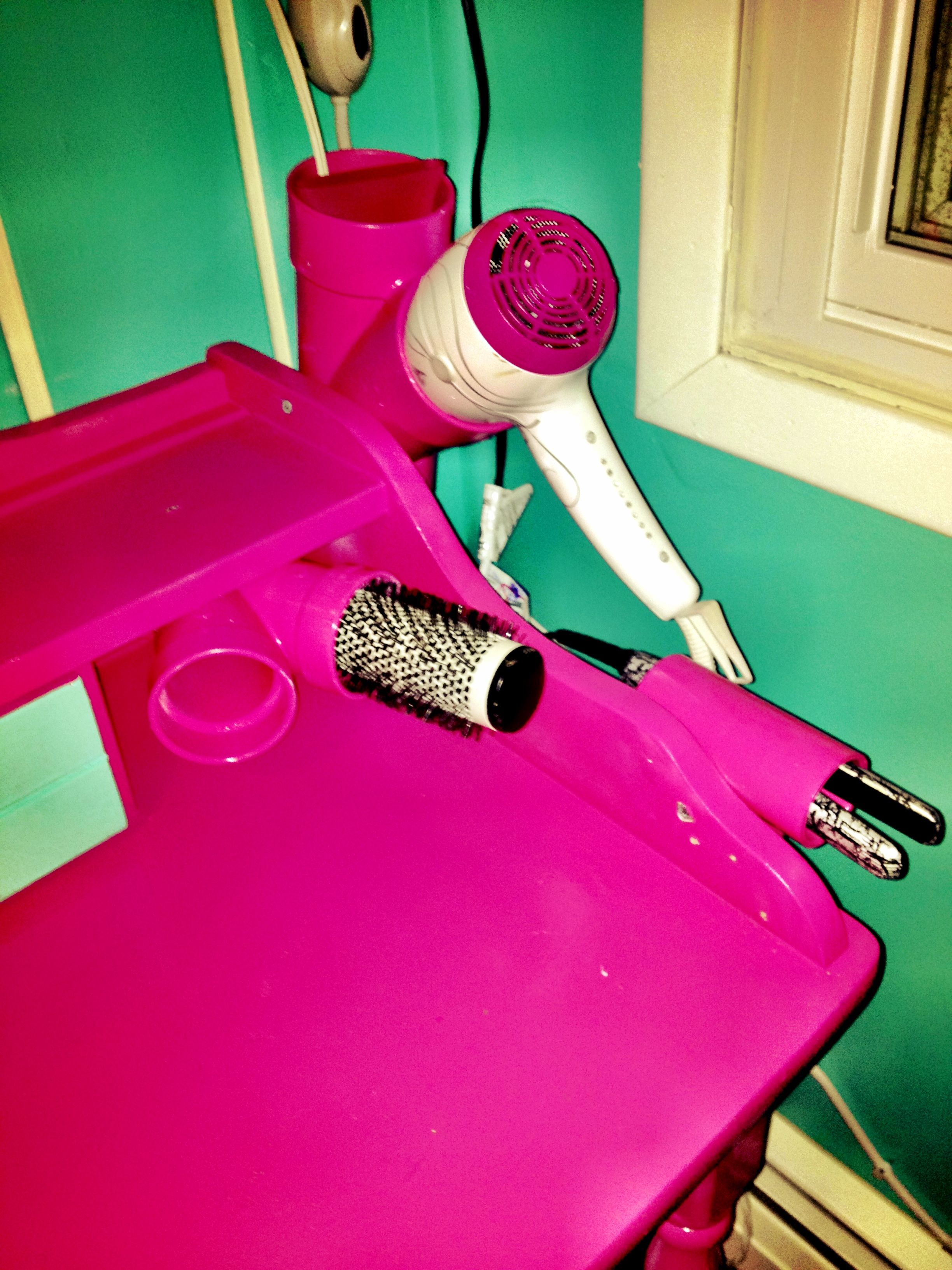 I used 3 PVC pipes from Home Depot for like less than a dollar a pice, spray painted them and screwed them to an antique desk to use as my home salon station:D