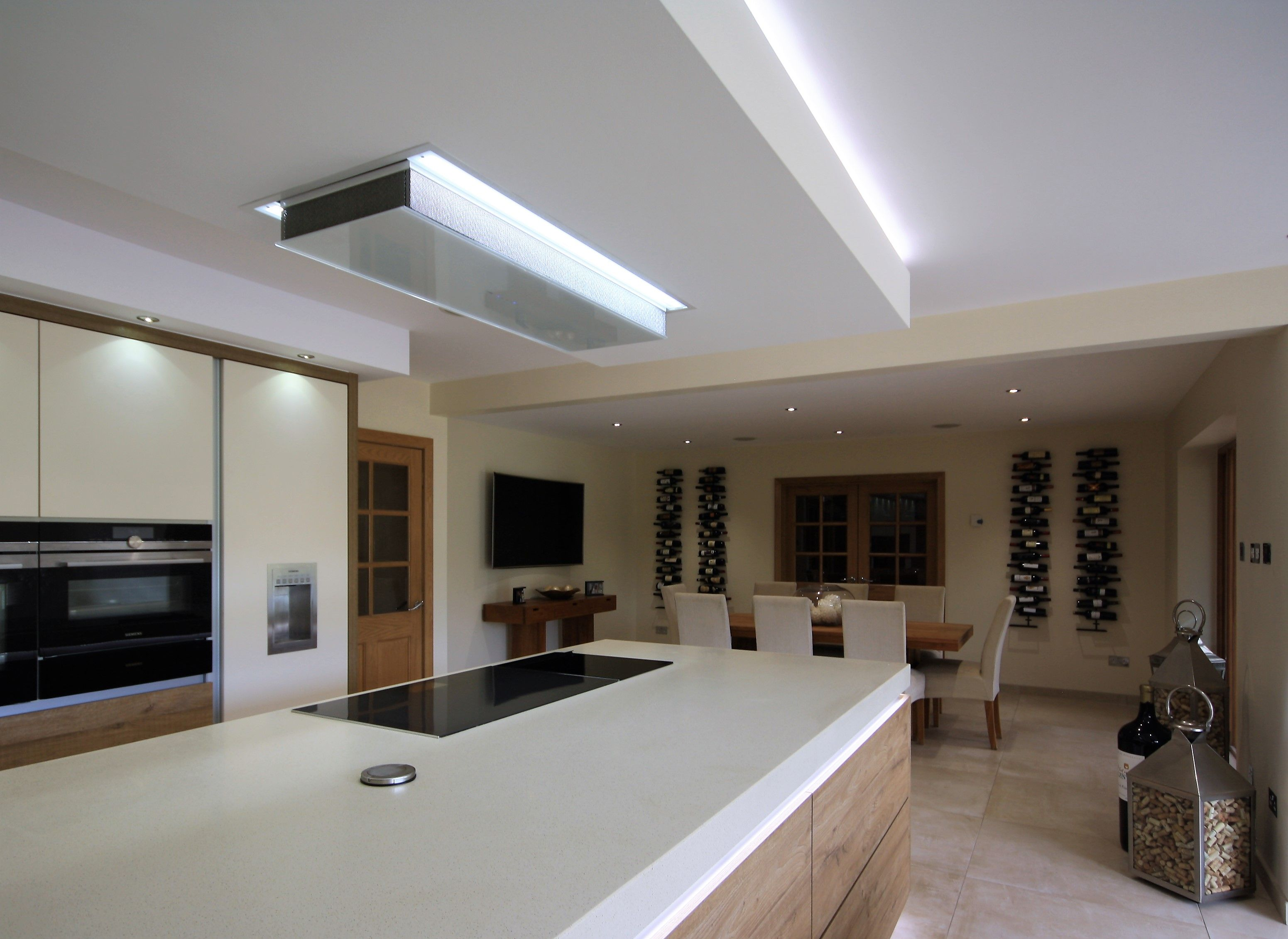 Ceiling Mounted White Extractor Hidden Within The Boxing Which Is The Same Length And W Ceiling Exhaust Fan Bathroom Ceiling Exhaust Fan Ceiling Fan In Kitchen