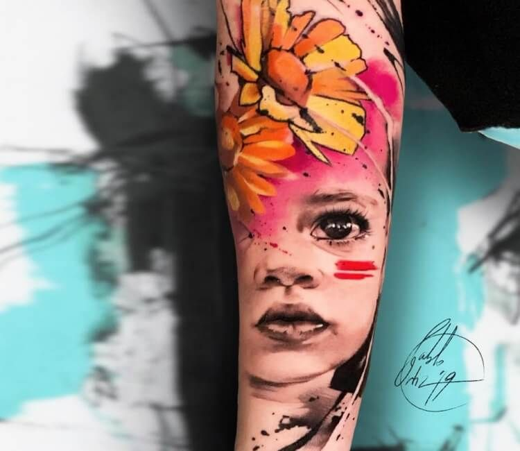 Child face tattoo by Pablo Ortiz