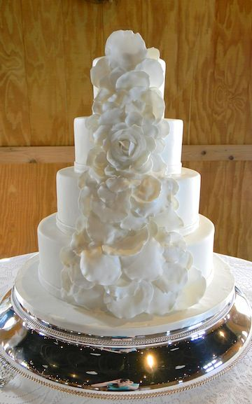 petal wedding cake all white wedding cake with flower petals cascading 18301
