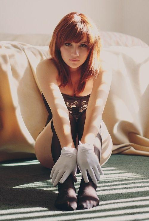 Hot redhead photo table corset