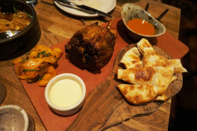 Crisp braised pork shank, butternut squash and shiitake kimchi, naan, and buttermilk dressing - Girl and the Goat