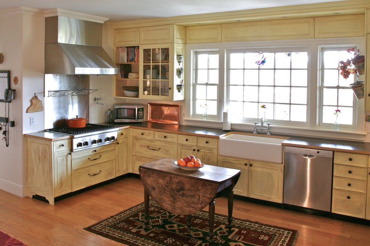 designing country kitchen with rustic island - http://www