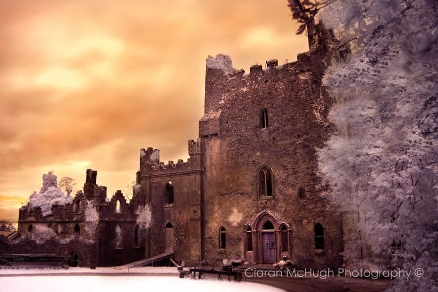 """""""The Leap Castle"""" -  Leap Castle is said to be the most haunted castle in Ireland and sits on a foundation of shear rock. The original castle (the central keep seen to the right of this photograph) is thought to have been built circa 1250 and was the principal seat of the fearsome Ely O'Carroll clan.  Leap Castle has had a horrific history with each passing century being punctuated by ferocious acts of violence.    Read more at  http://www.ciaranmchugh.com/?pagid=leap-castle"""