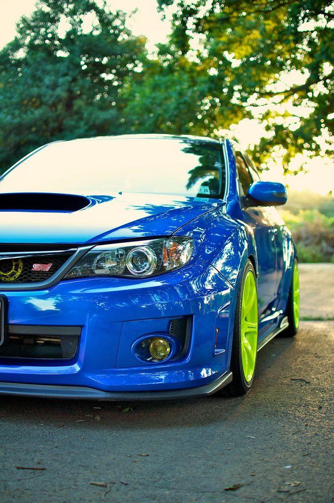 Subaru WRX STi, not a huge fan of those green rims. Still nice ...