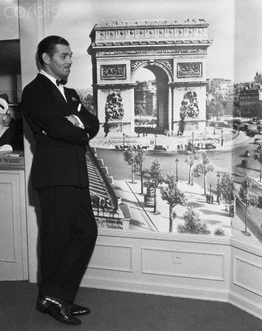 Clark Gable standing next to an image of the Arc de Triomphe! So much beauty...