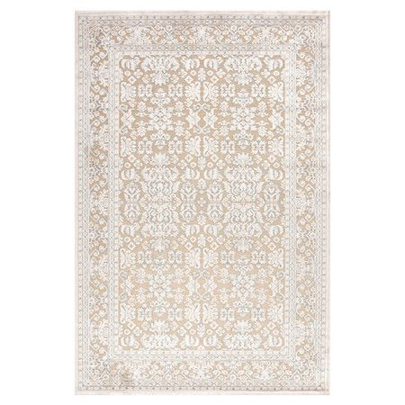 Anchor your living room seating group or define space in the den with this tufted chenille and art silk rug, showcasing a Persian-inspired motif for eye-catc...