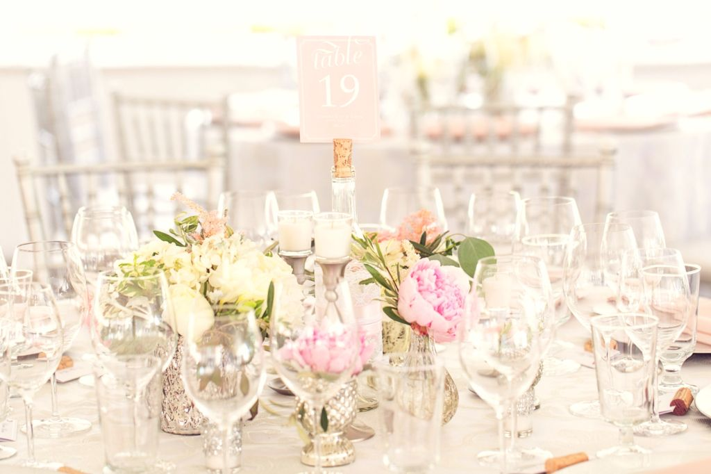 Wedding centrepiece made up of a cluster of small silver vases