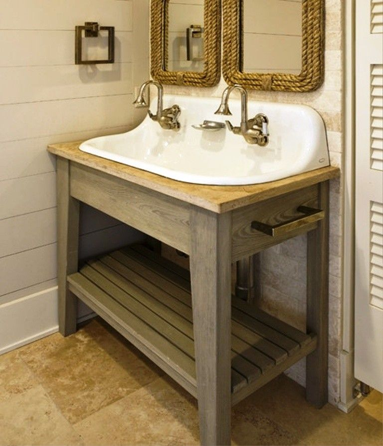 White kohler sink with gold tone water faucet and wooden sink stand ...