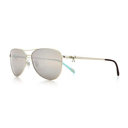 037468886db Tiffany Twist aviator bow sunglasses in pale gold-colored metal ...