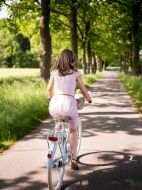 http://www.istockphoto.com/photo/mature-woman-walking-through-a-park-with-her-classic-bicycle-gm480348064-68939125?st=ad9ee38