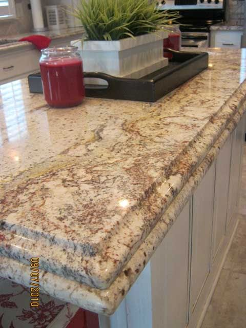Pics For White Springs Granite With Cherry Cabinets