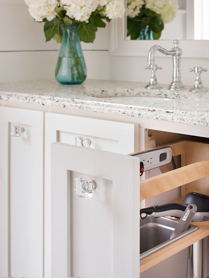 A Standard Cabinet Pull Out Unit With Modified Interior To Organize Hair  Dryer, Hot