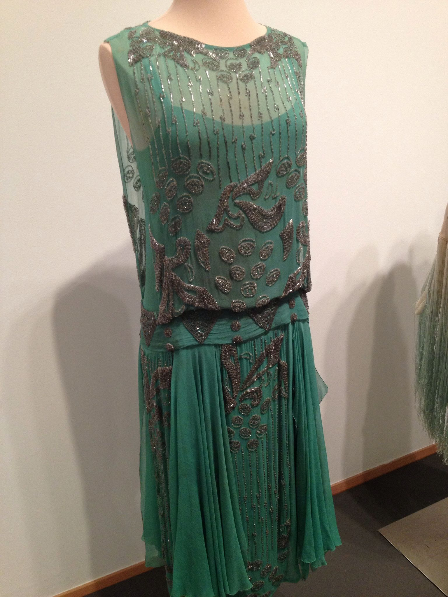 1920s evening dress from local museum exhibit. Tutankamon's tomb had only recently been discovered so clothes reflected the interest in Nile greens and often with Egyptian motifs. More
