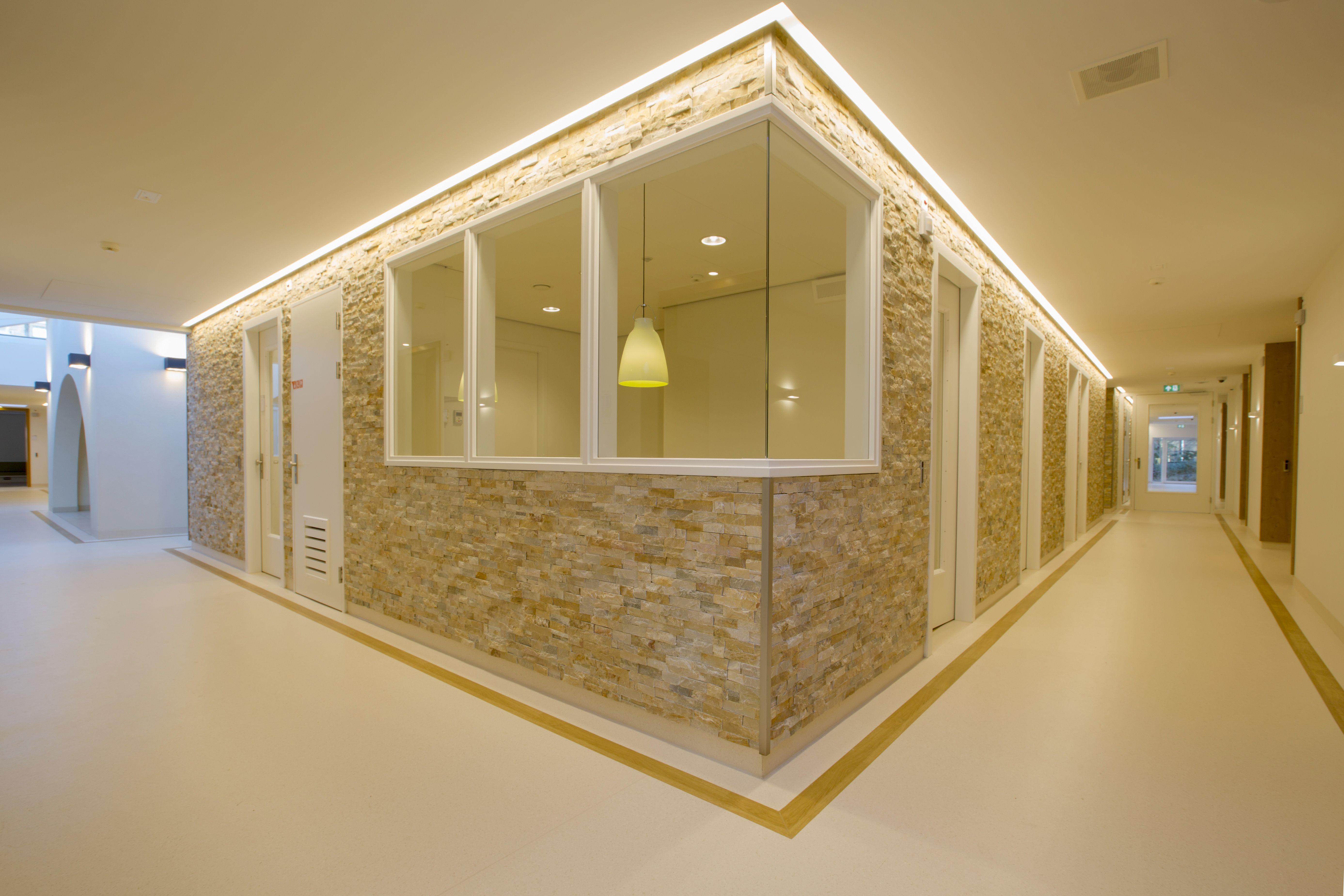 Hospital Interior Design Natural Stone Cladding In Corridor And Led Light CeilingHealing