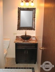 In a small powder room this vessel sink adds a level of - Small powder room sink ...
