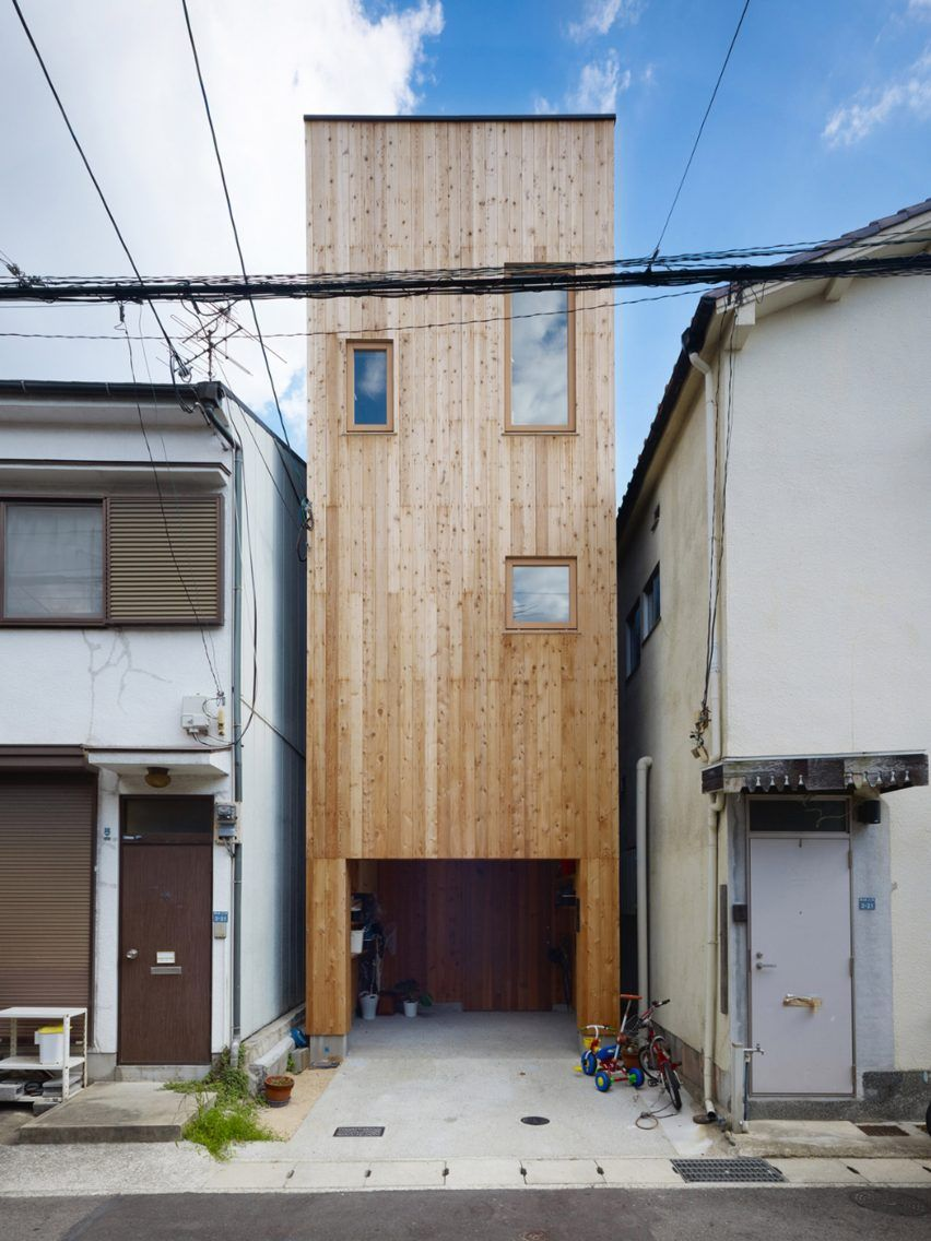 Japanese studio fujiwaramuro architects has completed an exceptionally narrow timber house in kobe featuring an