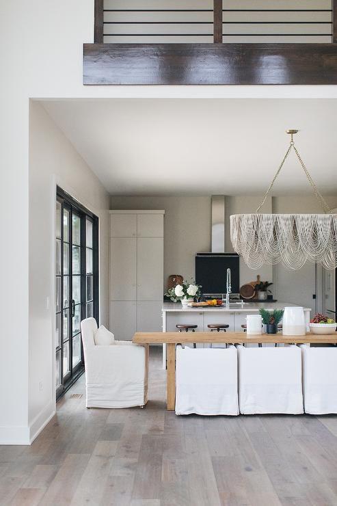 Stunning cottage dining room boasting a long golden oak ...