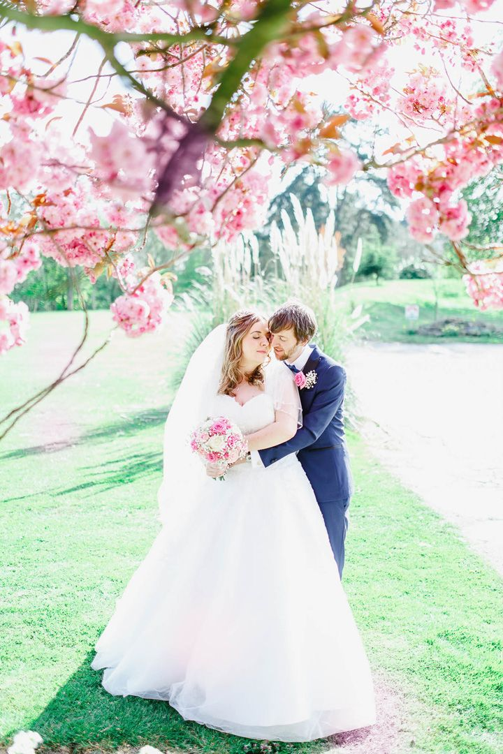 Bride and groom under cherry blossom three | pretty wedding portraits | fabmood.com #springwedding #weddingideas #springtime #portraits