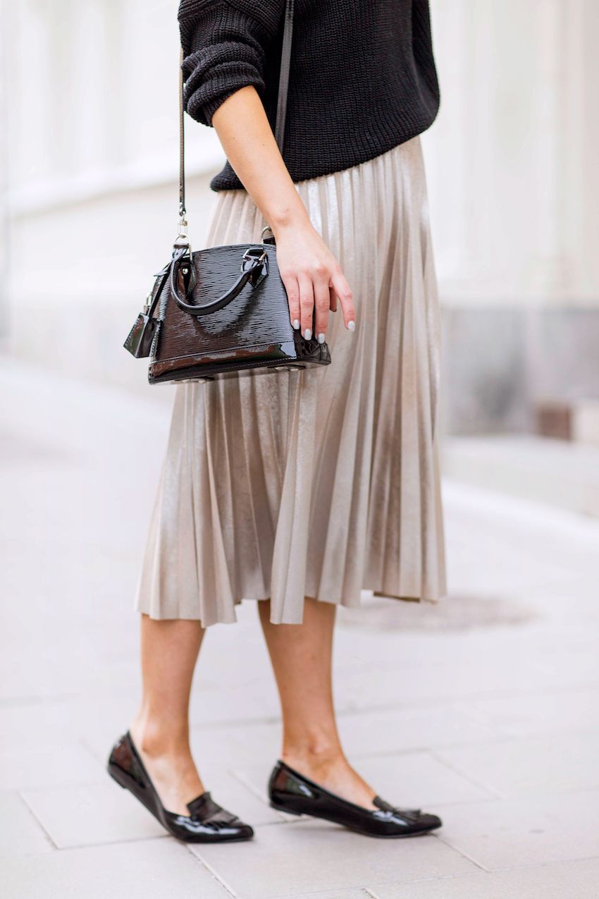Linda Juhola in black knit from Massimo Dutti, Zara pleated skirt in rose gold, Louis Vuitton bag and black Dune loafers