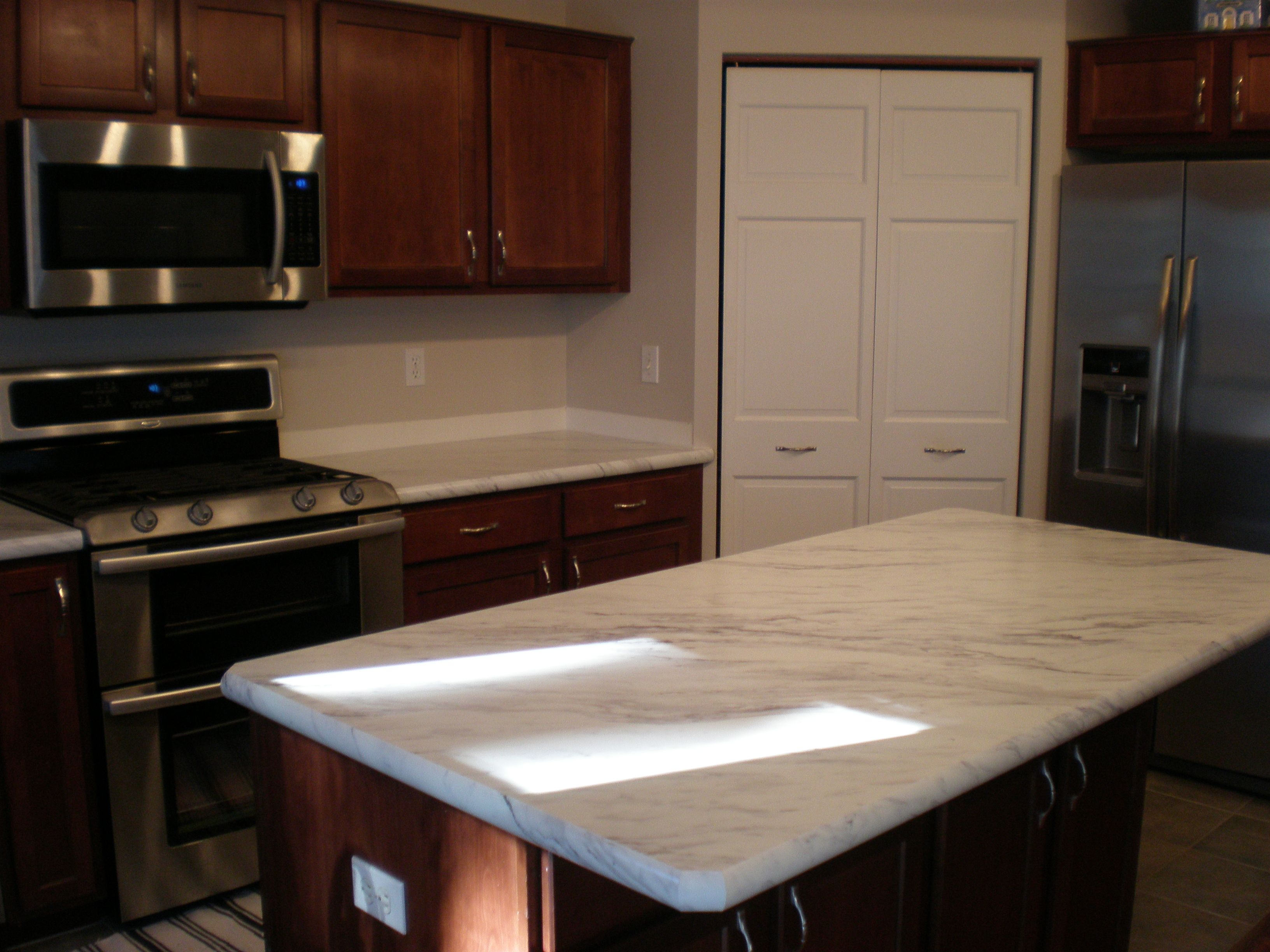 My New Countertops Have Transformed My Kitchen At A Reasonable Cost Calcutta Marble Premium