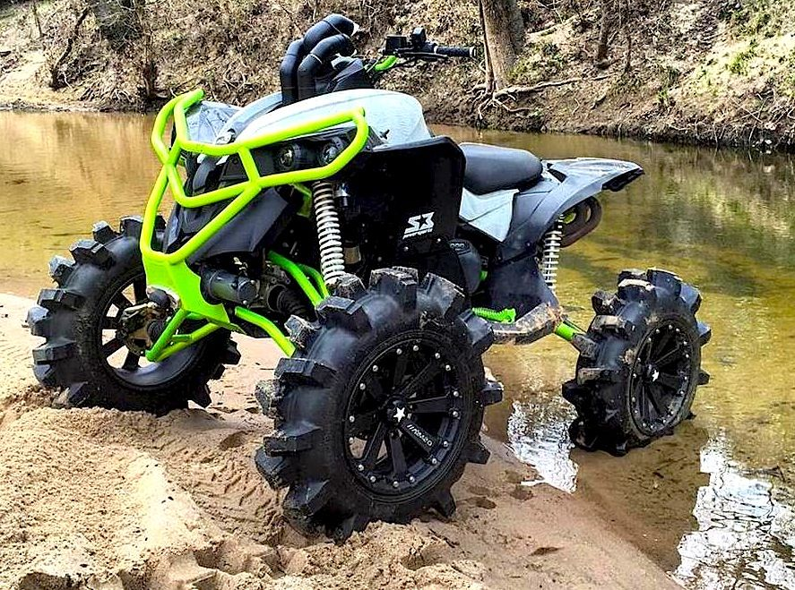 Big Wheels Big Tires And Lift Kits Come In Handy When Trying To Ride Across Swampland With The Extra Weight Of Those Com Atv Quads Four Wheelers Can Am Atv