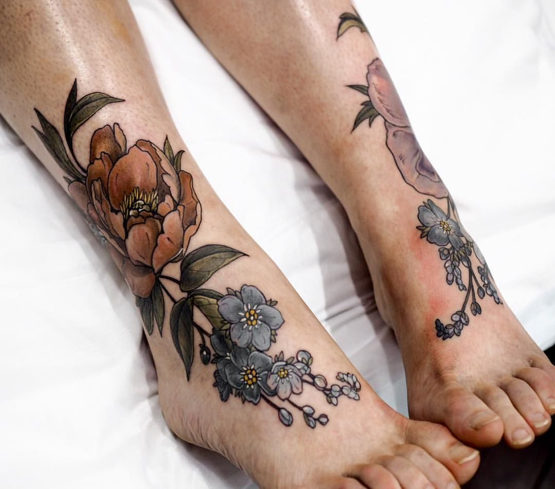 flower cover up tattoos on leg