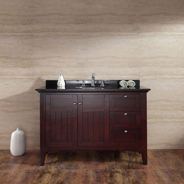 A tobacco brown wood stain adds refined style to this 42-inch bathroom vanity, featuring a rustic black granite single sink top. Two soft-close textured doors and three drawers provide plentiful stora