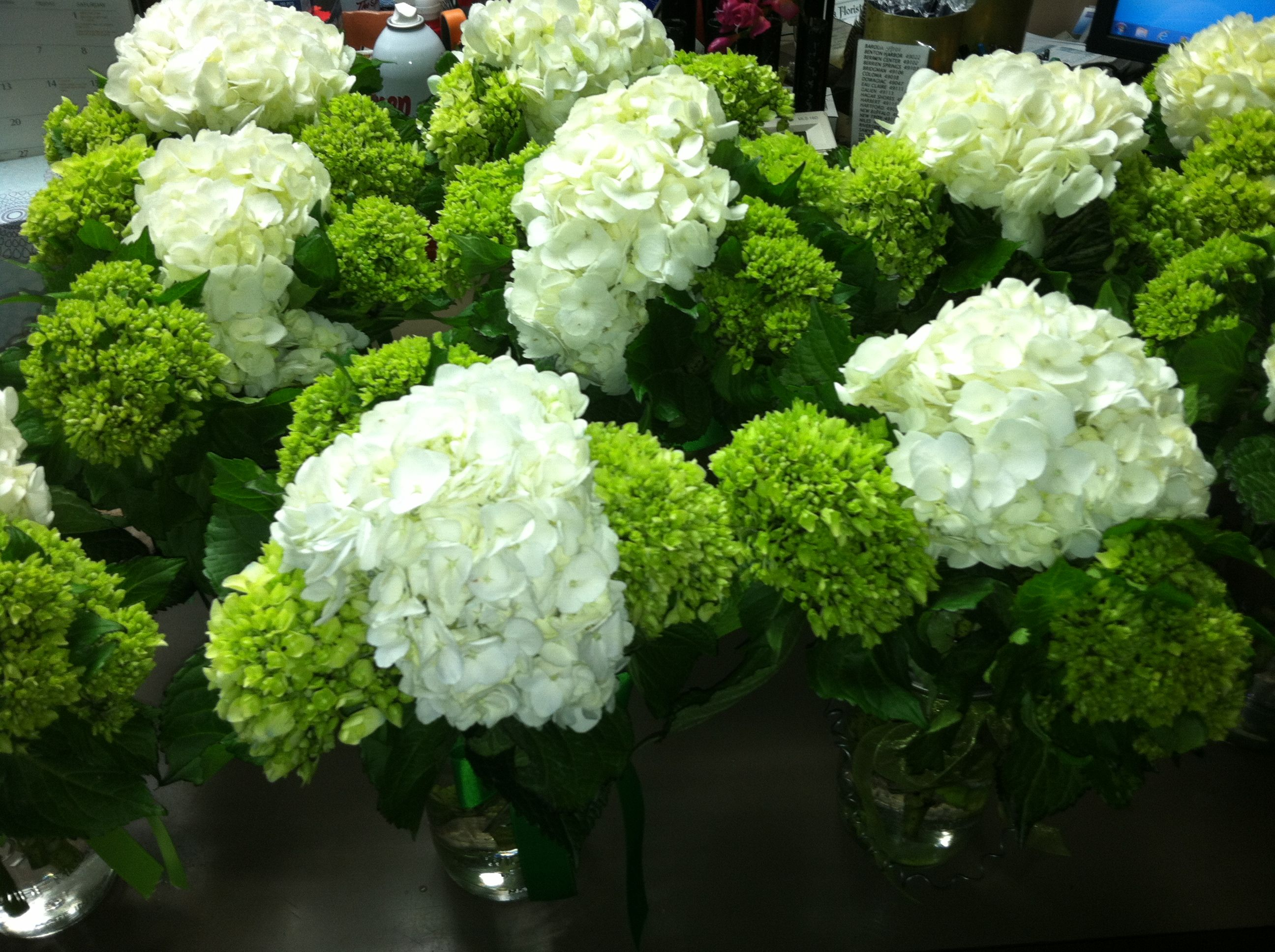 Green and white hydrangea centerpieces in mason jars