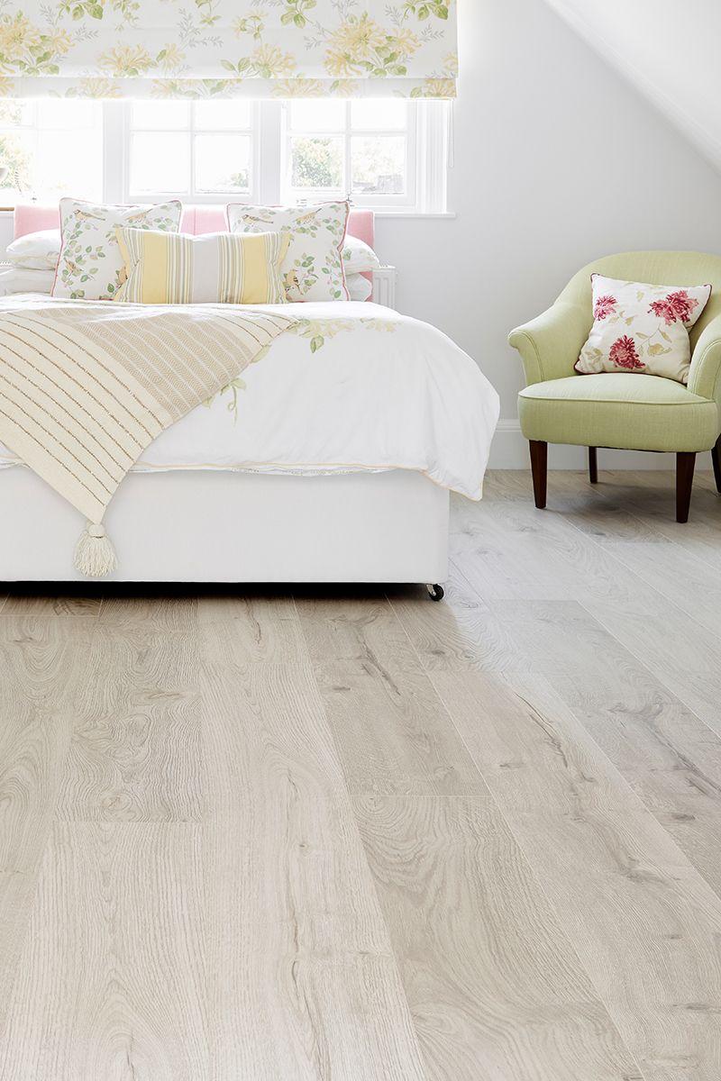 Vantage Wood 14mm Laminate Flooring Snow Oak Has An Elegant Sophisticated Look Thanks To It White Laminate Flooring Bedroom Laminate Flooring Bedroom Flooring