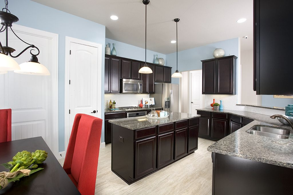 Gehan homes kitchen light blue walls red accents dark for Grey floor black cabinets