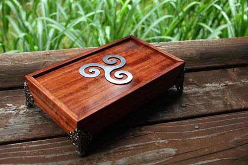 The perfect dice box for tabletop and RPG gamers, finely crafted in a variety of wood with customizable features. Holds 96 dice!