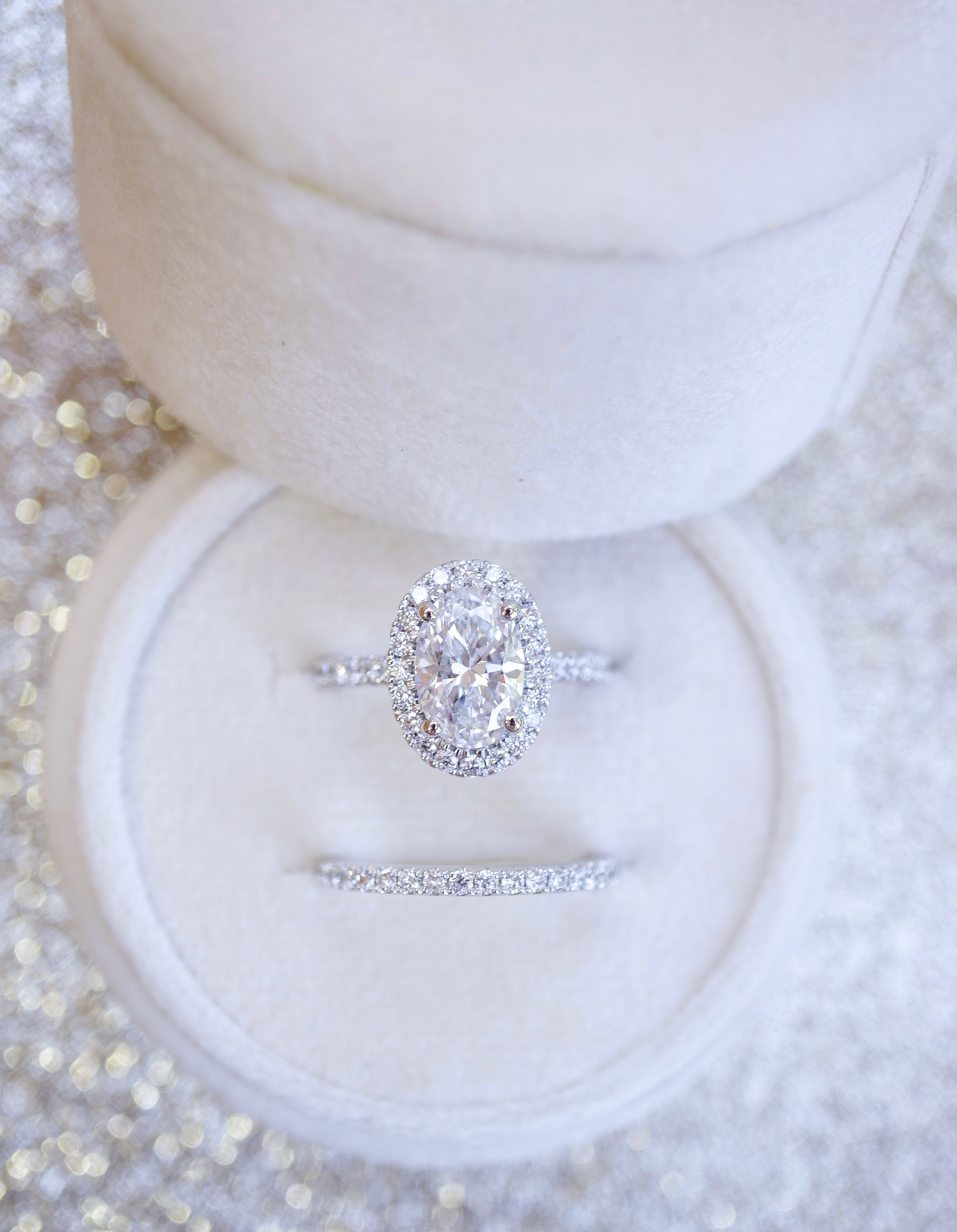 Oval Halo Diamond Engagement Ring With Matching Wedding Band