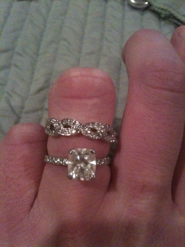 Love the simple engagement ring and infinity wedding band combo.. Perfect :)