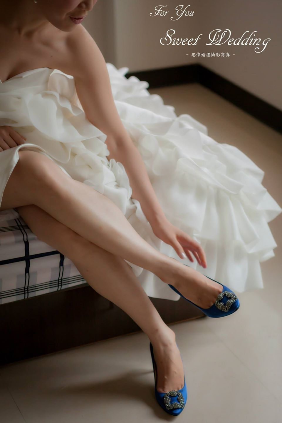 In the soft light of the bride dressed in a navy blue heels