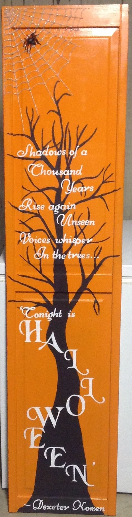 I created this sign from an old door the poem by dexter kozen is