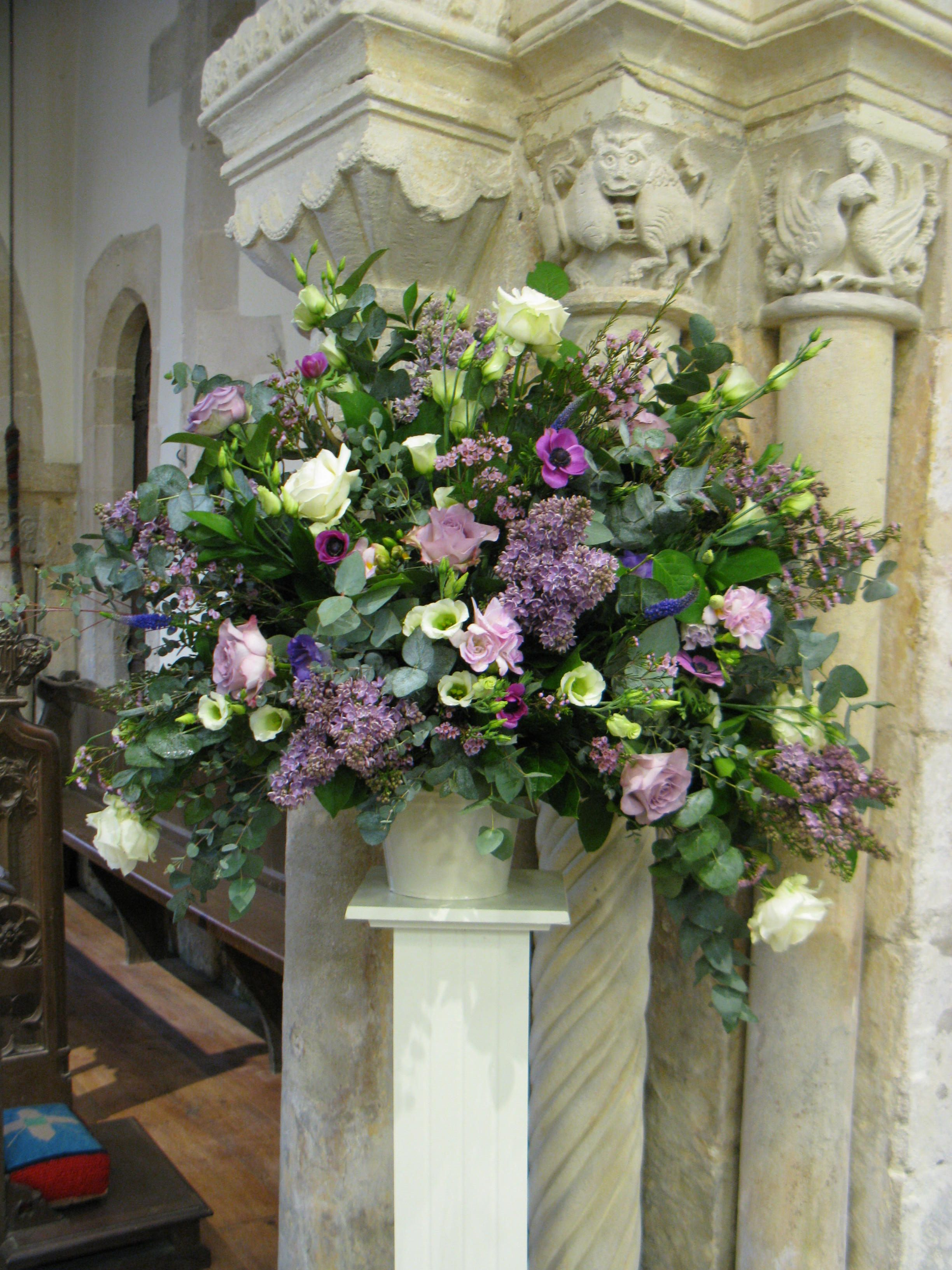 A Pedestal From a Spring Wedding in Jewel Coloured Flowers